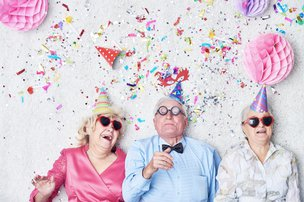 Autumn Years Care - Home Care - Thame elderly ladies and gentleman having a party