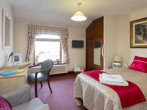 Bedroom in Crabwall Hall Care Home