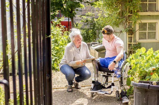 Bluebird Home Care in Colchester man with physical difficulties with carer