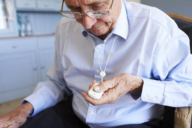 Bluebird Home Care in Enfield elderly man with personal alarm