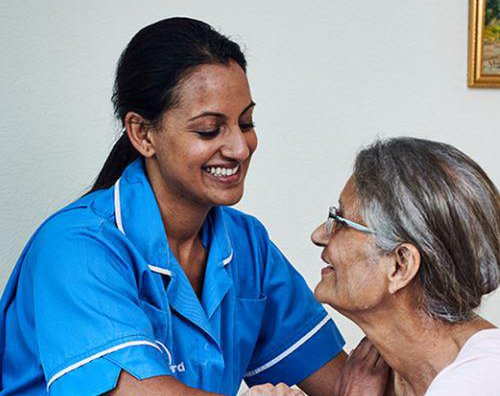 Bluebird Care Birmingham North Home Care Service User with Care Giver