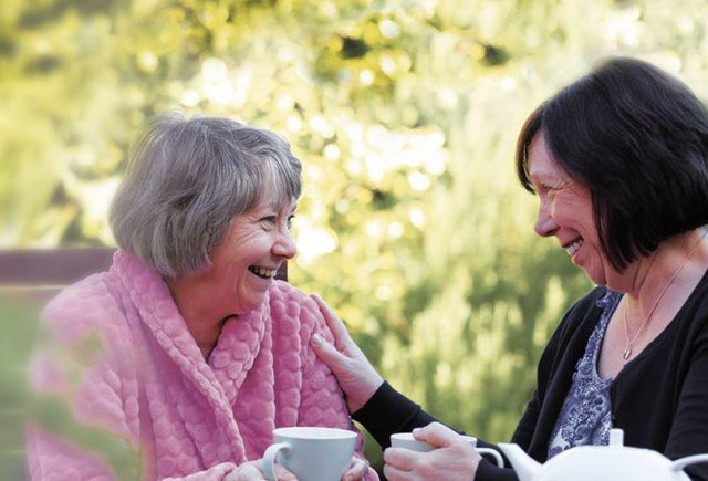 Right at Home Bromley Home Care elderly lady laughing with younger lady