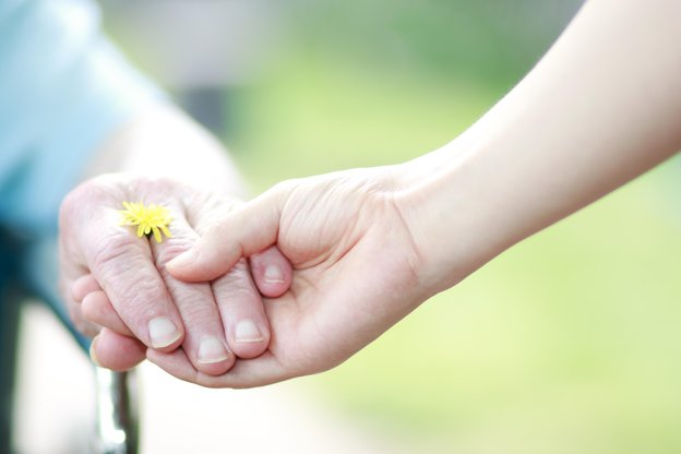 heritage healthcare tandridge client supporting care-seeker hand holding