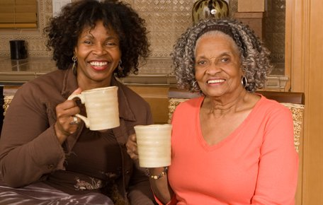 DT Home Care Services in Birmingham elderly lady with daughter enjoying cup of tea