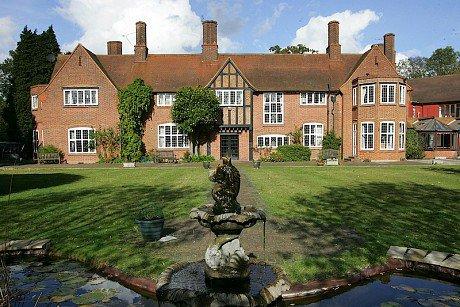 Denham Manor Nursing Home in Uxbridge rear exterior of home with large garden