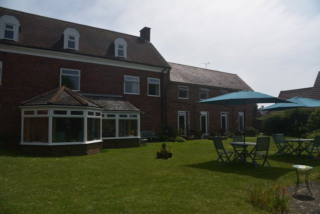 Fairways Residential Care Home in New Romney exterior of home with garden