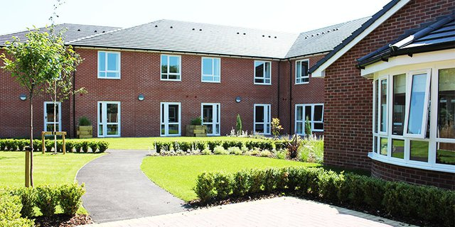 Four Oaks Care Home in Manchester exterior of home