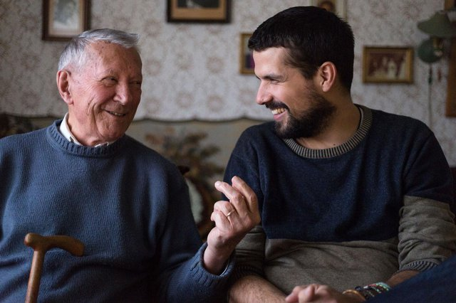 Edyn Home Care in London elderly man laughing with younger man