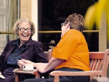 The Elms Nursing Home in Bembridge, Isle of Wight elderly lady with carer outdoors