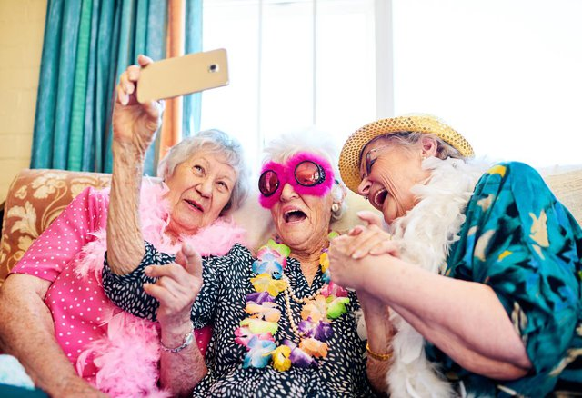 Heatherdene Nursing Home in Bexhill On Sea elderly lady friends dressing up and taking selfie