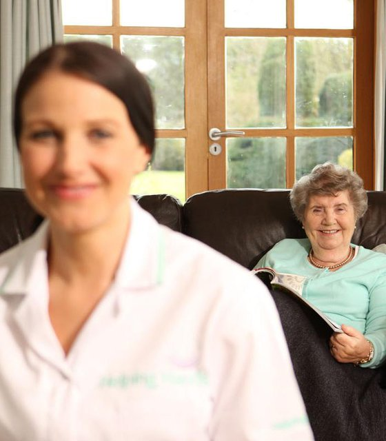 Helping Hands Home Care in Cheltenham & Gloucester carer with elderly lady