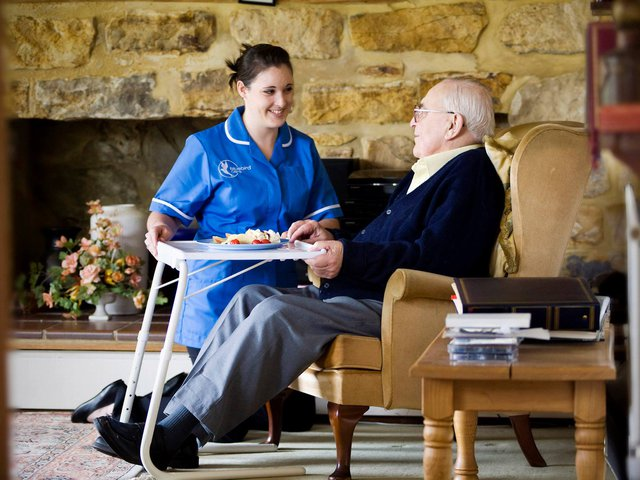 Bluebird Care West Bromwich Home Care in Oldbury elderly service user with care giver