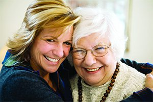 Home Instead Senior Home Care in West Norfolk elderly lady hugging younger lady