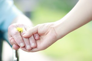 Home Instead Home Care in West Leicestershire holding hands