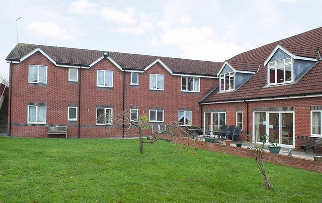 Island Court Nursing Home in Dudley exterior of home with garden