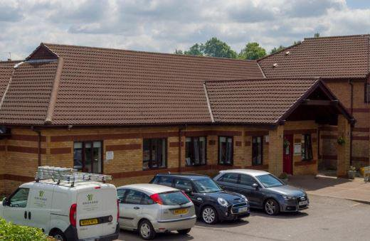 Three Bridges Nursing & Residential Home in Warrington exterior of the home with parking