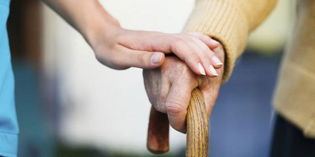 Pastures Home Care in Leicester holding hands