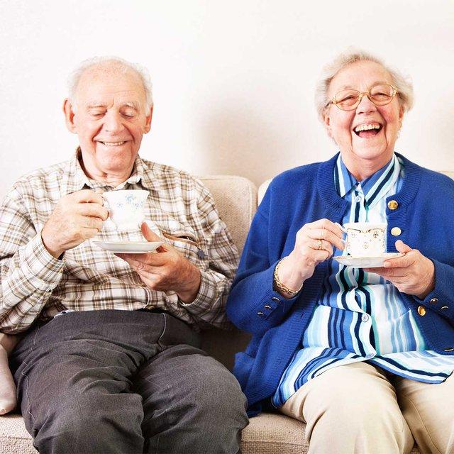 Arbour Companions & Home Care in Weybridge elderly couple enjoying cup of tea