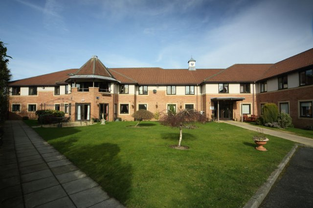 Ponteland Manor Nursing Home in Newcastle Upon Tyne exterior of home with garden