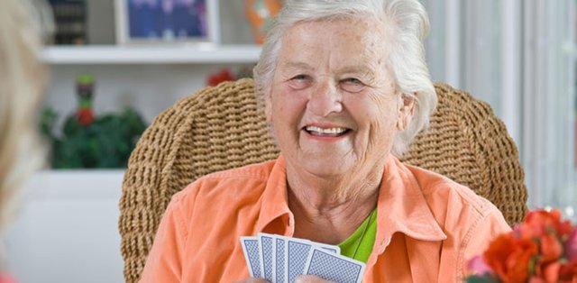 Radfield Home Care in Chester elderly lady playing cards