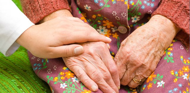 Radfield Home Care in Worcester holding hands