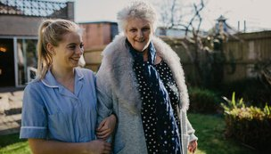 Waterloo Care Home - Carer walking with resident