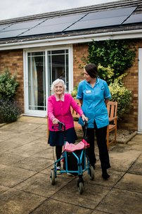 Resident with Carer outside at Avenue House