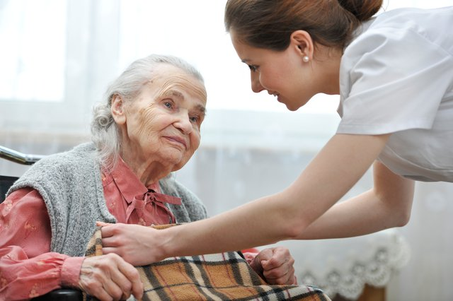 AevaCare Home Care in Rickmansworth care giver helping elderly lady with blanket
