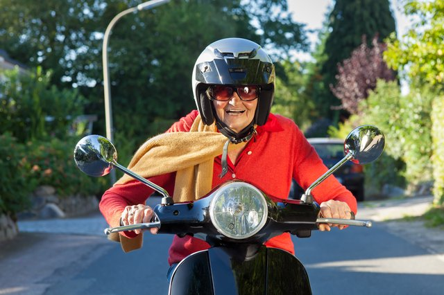 Right at Home Central London Home Care in London elderly lady on motorbike
