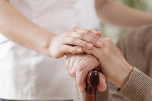 Nest Home Care in Windsor holding hands