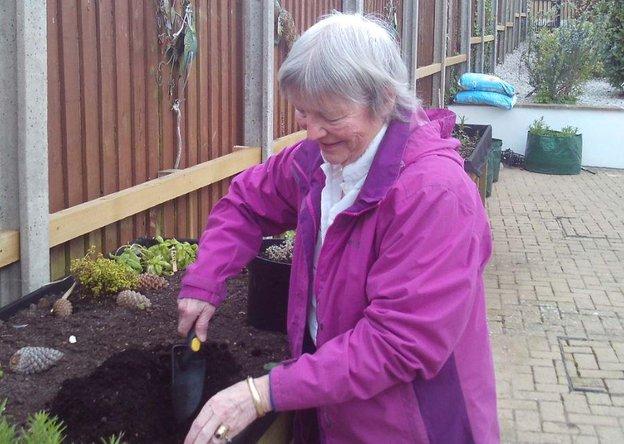 Trecarrel Care Home in Tywardreath, Cornwall resident gardening