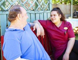 Tudor Bank Nursing Home - resident with carer