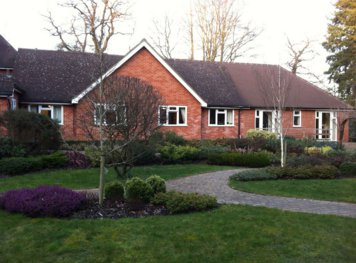 Warrengate Nursing Home in Tadworth rear exterior of home with garden