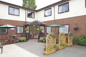 Whitby House Nursing Home in Ellesmere Port exterior of home with courtyard