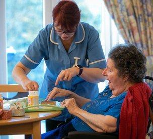 Woodside Hall Nursing Home - resident with carer